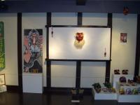 Back wall showing tengu mask bought in Okayama and, on the right, Minna's masks; note tengu geta (wooden clogs) on floor