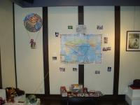 World trip tengus display - map of two tengus travel routes, and their giftsm photos, and diaries on the table below