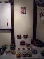 Minna mask corner with photo of Minna at work